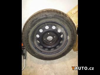 Prodám Ford Escort sada pneu 185, 60R, 14´ 82H